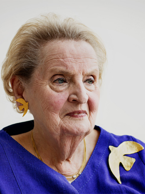 Madeleine Albright is photographed at the Albright Stonebridge Group offices in Washington, D.C. wearing a replica of the Cécile & Jeanne dove pin given to her by Leah Rabin.